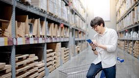 Asian man shopper checking his shopping list royalty free stock photography