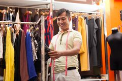 Asian man shopping choosing dress shop tailor. Fashion clothes dress designer Stock Images