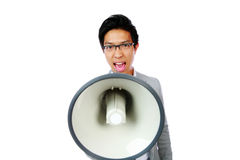 Asian man shouting with megaphone Royalty Free Stock Photos