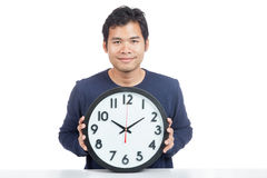 Asian man show a clock and smile Stock Image