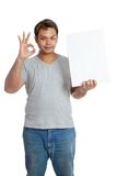 Asian man show ok sign  hold a vertical  blank sign Royalty Free Stock Photography