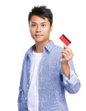 Asian man showing with credit card Stock Photography