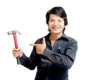Asian man showing a hammer. Idea and concept Asian man showing a hammer Royalty Free Stock Image
