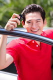 Asian man showing key of his car Stock Images