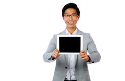 Asian man showing tablet computer screen Stock Images