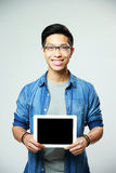 Asian man showing tablet computer screen Stock Photography