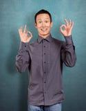 Asian Man Shows OK Royalty Free Stock Photo