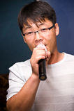 Asian man singing Stock Image