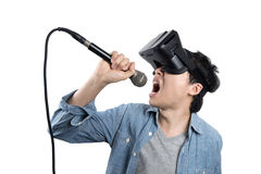 Asian man singing with VR Royalty Free Stock Photos