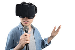 Asian man singing with VR Royalty Free Stock Photography