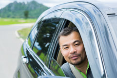 Asian man sitting in car Royalty Free Stock Image