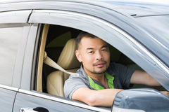 Asian man sitting in car Stock Images