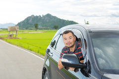 Asian man sitting in car Royalty Free Stock Image