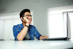 Asian man sitting at his workplace Stock Photo