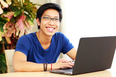 Asian man sitting at the table with laptop Stock Image