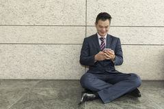 Asian man sitting with a tablet computer. Stock Images