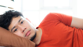 Asian man sleeping on bed. Stock Image