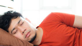 Asian man sleeping on bed. Royalty Free Stock Photos