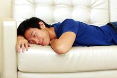 Asian man sleeping on the sofa Stock Photo