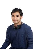 Asian man smile with a headphone on his neck. Isolated on white background Royalty Free Stock Photography