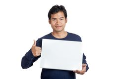 Asian man smile  thumbs up with a blank sign Royalty Free Stock Photo