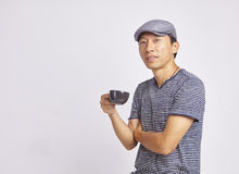 Asian man smiling at camera holding coffee cup isolated. On white Stock Photos