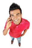 Asian man smiling using a mobile phone Royalty Free Stock Photos