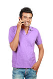 Asian man smiling using a mobile phone Stock Photo