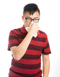 Asian man sneezing Stock Image