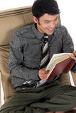 Asian man sofa book Stock Images