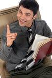 Asian man sofa book stock images