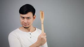 Asian man with spade of frying pan. Happy Asian man with spade of frying pan stock photo