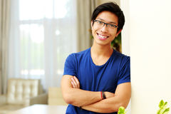 Asian man standing with arms folded Stock Images
