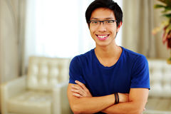 Asian man standing with arms folded Stock Photos