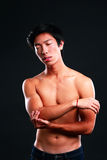 Asian man standing with closed eyes Royalty Free Stock Photography