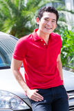 Asian man standing in front of car Stock Images