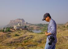 An Asian man standing on the hill royalty free stock images