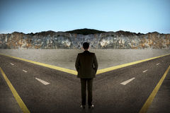 Asian man standing in the middle of cross road stock image