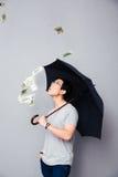 Asian man standing in the rain of money Stock Photo