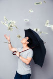 Asian man standing in the rain of money Stock Photos
