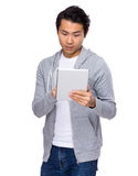 Asian man standing with tablet computer. Isolated on white background Royalty Free Stock Images