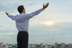Asian man starting his morning on a to-be successful day. Man accepts God into his life. Success and inspirational theme. Love and happiness Stock Images