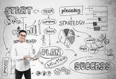 Asian man and startup sketch on concrete Stock Photos
