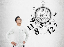 Asian man and stopwatch Stock Photo