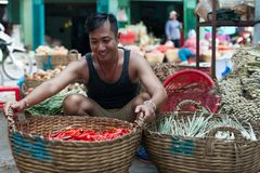 Asian man street market sell basket red chilly stock photography