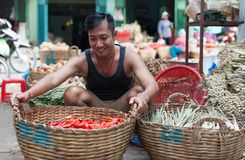 Asian man street market sell basket red chilly Royalty Free Stock Images