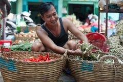 Asian man street market seller bunch green onion Stock Image