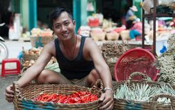 Asian man on street market smile sell red chilly Royalty Free Stock Photos