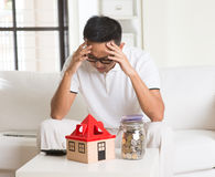 Asian man stress on high property Royalty Free Stock Photography