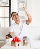 Asian man stress on high property Stock Image